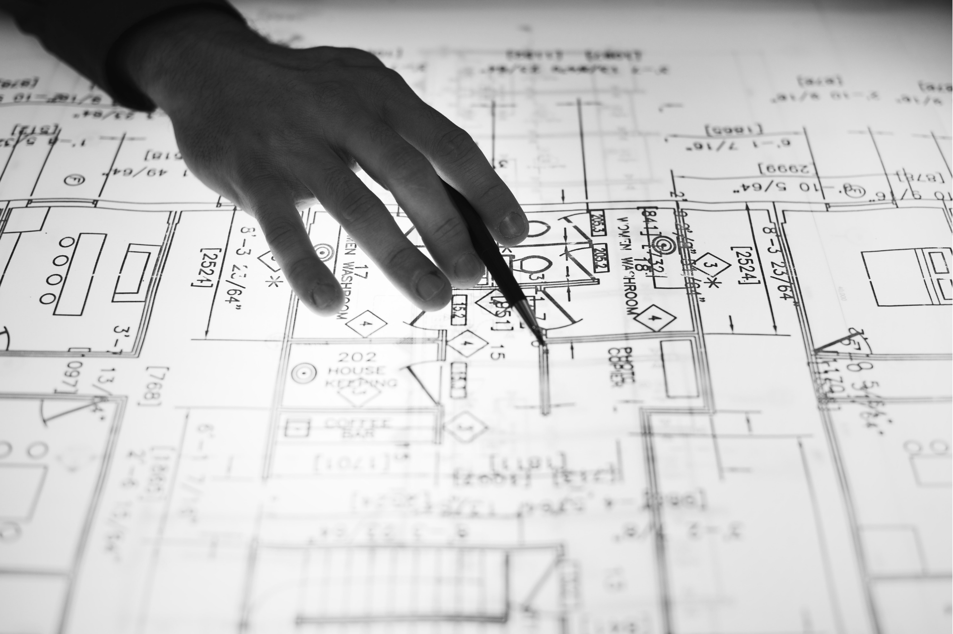 Hand with pencil pointing to part of lighting design